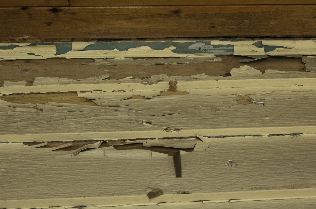 Peeling paint on clapboard