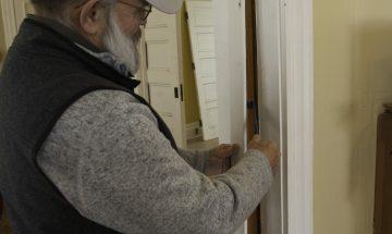 Pry trim from pocket door