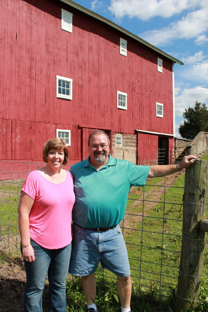Kris and Mike Maroska, sixth-generation operators of Walnut Leaf Farm, maintain the agricultural landmarks built by Mike's great-grandfather Johnston Frank, including an early twentieth-century transverse frame basement barn.