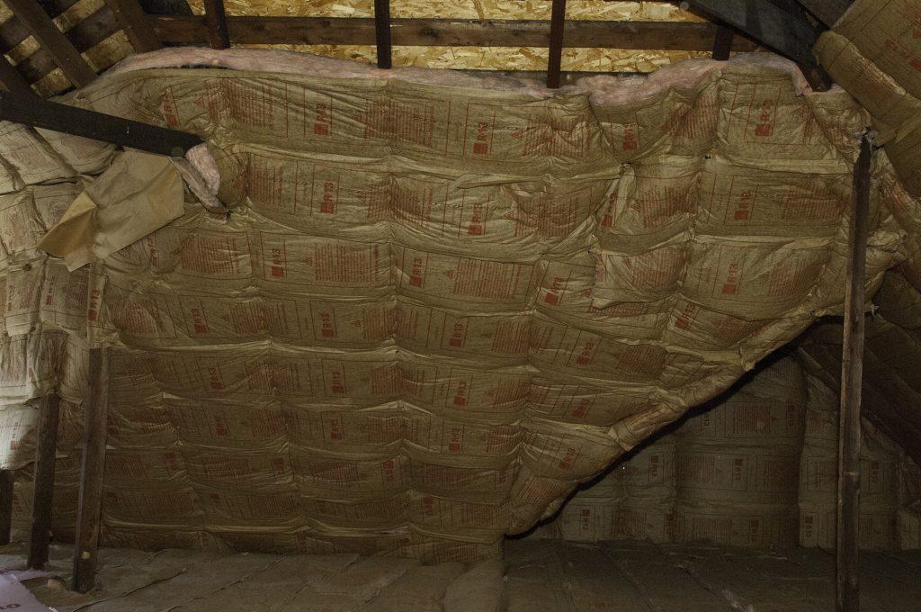 Attic insulation across trusses